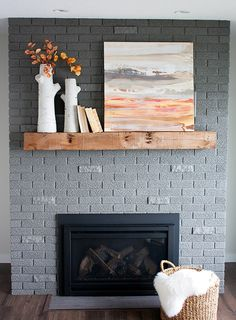 70's brick fireplace makeover. Amazing transformation - love the new SW gray paint color.