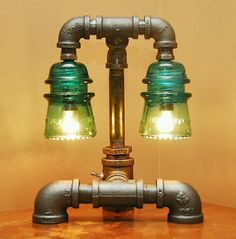 Vintage glass electric insulators turned into industrial lamp! Awesome idea. I've seen these at flea markets everywhere!