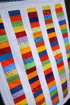 coin stack quilt - love the simple quilting (this would be a quick easy one for my next charity quilt)