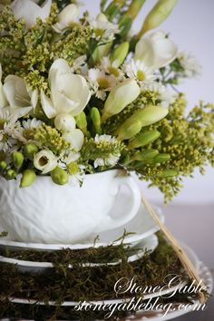 Arranging flowers from grocery   by Stone Gable