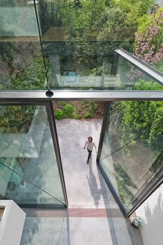 A renovated house in Antwerp, designed by Belgian studio Sculp IT, features the world's largest pivoting windows.