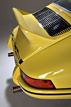 Certainly NOT the ugly duckling. Early 70s Porsche 911 Carrera with ducktail spoiler.