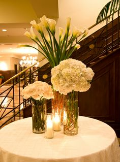 not digging the calla lillies tho. Calla Lily Wedding Flowers, Modern Wedding Flowers, Modern Centerpieces, Wedding Reception Centerpieces, Table Centerpieces, White Flower Arrangements, Wedding Arrangements, Cream Flowers, Pretty Flowers