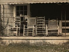 four rocking chairs on an abandoned front porch by maj488/mike, via Flickr