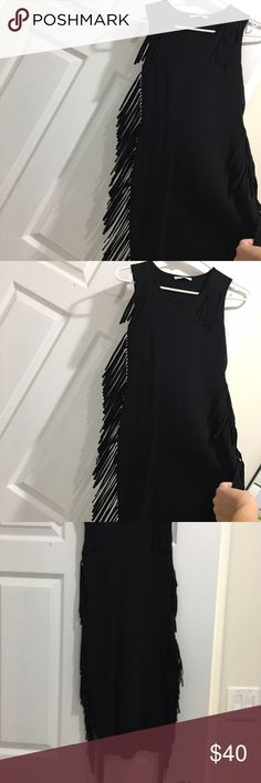 Little black fringe dress.  XS ✨worn once✨ Dress is very stretchy in excellent clean condition. 63% viscos 37% nylon  purchased at Bloomingdales over the summer.  Fits just above the knew. Very flattering and fun. Dresses Midi