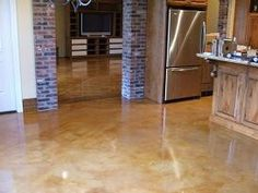 Concrete floors- This is what we will do in the downstairs den/bar after tearing out the wall to wall carpet.