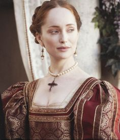 I think this is from TV. I absolutely love the way this is done - the jewelry, the makeup, the hair, and all the colors done on her for this costume. She's amazingly beautiful, whoever she is, and she looks just like a Renaissance painting.