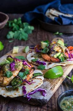 Grilled shrimp tacos with tomatillo salsa and homemade tortillas - bursting with flavor, juicy shrimp, grilled ppoblano peppers and tomatoes, topped with freshly made salsa verde, and served over soft homemade flour tortillas.   www.viktoriastable.com