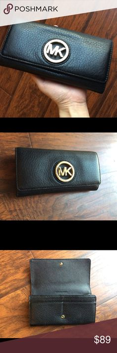Michael Kors Fulton Leather Wallet Black Used only two times, like new condition! Soft leather wallet with gold tone medallion plaque. Plenty of compartments and card slots. Interior features middle zip compartment, 14 card slots, and 2 bill compartments. Snap closure. Michael Kors Bags Wallets