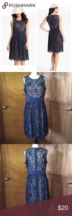 "NWT Eliza J Lace Fit Flare Navy Blue Dress Size 12 Brand new with tags! Eliza J beautiful Lace overlay dress. Size 12. Navy blue overlays a taupe fully lined slip. Hidden Back zip closure. 41"" long, 19.5"" bust, 16"" waist. Rich lace fashions a vintage-inspired, sleeveless dress refined by a solid waistband before flaring into an accordion-pleated skirt with an elegantly scalloped hem. 58% nylon 42% cotton. Bundle and save! Fast shipping! Eliza J Dresses Midi"