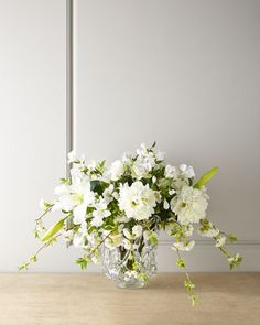 """Lilies and Lace Faux Floral  by John-Richard Collection at Neiman Marcus .com   This stunning white faux floral arrangement is beautifully crafted from an assortment of Asian lilies, cherry blossoms, peonies, and the palest pink roses. A glass container with an open, lace-like design adds to its allure   35""""dia x 22""""h   720.00 USD"""