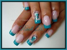 Gorgeous turquoise french manicure with a cute accent finger design of a butterfly.