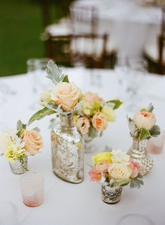 Vintage silver vases and bottles as #centerpieces #silver #vintage