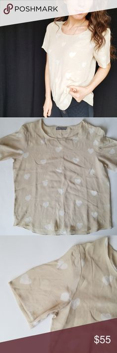 Zoe + Sam 100% silk heart print top -B4 Adorable Zoe + Sam silk top! Pretty cream color with white heart print. So soft! Size medium. Used item, pictures show any sign of wear or use.   Bundle up! Offers always welcome!  Shop my husband's closet!: @kirchingeraaron Zoe + Sam Tops
