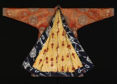 Man's coat, Kashgar, 1801 - 1869. Eastern Turkestan (now Xinjian, China). Silk, embroidered with silk and metal thread; ikat-dyed silk and cotton lining