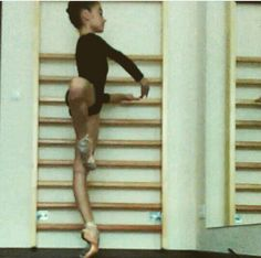 Ballet student, pointe shoes, working on turnout...