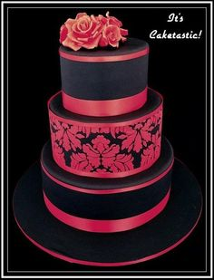 I love that the bride and groom were willing to take a chance and use colour for their wedding cake.  It was three tiers of dark chocolate mud cake covered in black fondant.  The damask pattern was applied using a stencil using red royal icing.  The roses were made from fondant.  It was awesome to be able to do something that little bit different.