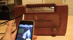 turn a vintage radio into an iphone amplifier. @Kathy Hayes you should get David do to this with your stand radio!