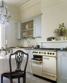 Plate racks decoratively display dinnerware, and stand out in the world of kitchen custom space saving features.