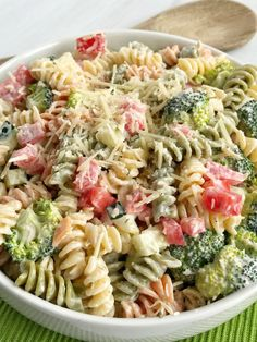 Ranch pasta salad is an easy and delicious side dish for summer picnics and bbq's. Only 6 ingredients and minutes to prepare. Tender pasta, cucumber, broccoli, tomatoes, and parmesan cheese covered in ranch dressing. So simple!