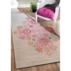 Bring style and elegance into your home with this rug. This rug is hand-looped with 100% wool and features a durable and plush pile suitable for high traffic areas.