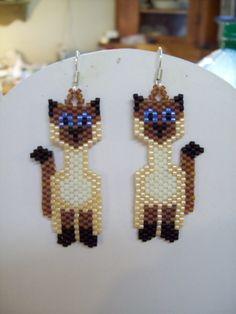 Oh soo cute Native Beaded Siamese Cat Earrings. $15.00, via Etsy.
