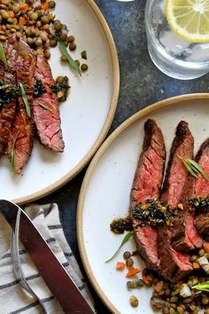 NYT Cooking: This recipe came to The Times in 1990 in Pierre Franey's 60-Minute Gourmet column. A lentil salad (we used those tiny French green lentils, but you can use the standard supermarket variety as well) is dressed with a Dijon mustard vinaigrette, then topped with skirt steak that's been seared in a cast-iron pan. A simple sauce, made by deglazing the pan with butter, garli...