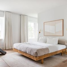 modern bedroom design, neutral bedroom decor with upholstered headboard and white bedding with modern pillows, nightstand decor, nightstand styling with artwork over bed, neutral rug in master bedroom decor with bench at end of bed Minimalist Bedroom, Minimalist Decor, Minimalist Bed Frame, Minimalist Style, Home Decor Bedroom, Bedroom Furniture, Bedroom Ideas, Bedroom Curtains, Bedroom Wallpaper