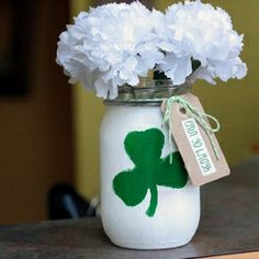 Turn a mason jar into a festive St. Patrick's Day vase with a little paint, twine and text.