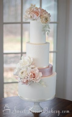 Soft ivory and blush pink wedding cake with handmade sugar flowers. www.sweetpassioncakery.com