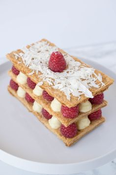 Raspberry Napoleon. A striking dessert that is surprisingly easy to make. Layers of crispy puff pastry layered with lemon custard and fresh berries and topped with shaved white chocolate. A dessert than can be shared...or not.