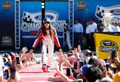 Danica Patrick Photos Photos - Danica Patrick, driver of the #10 TaxACT Chevrolet, greets fans as she is introduced prior to the NASCAR Sprint Cup Series Ford EcoBoost 400 at Homestead-Miami Speedway on November 20, 2016 in Homestead, Florida. - NASCAR Sprint Cup Series Ford EcoBoost 400