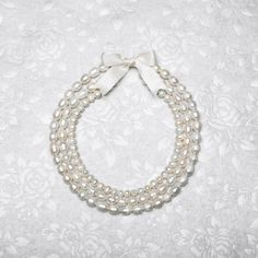 Michaels.com Wedding Department: Triple Strand Pearl Necklace Make your wedding day truly unique. Adorn yourself with beautiful handmade jewelry and accessories – like this simply stunning pearl necklace.