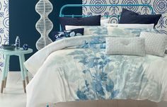 Beautiful blues are the starring colours in this fresh and appealing design that features a distinctive and decorative foliage theme. A quil.