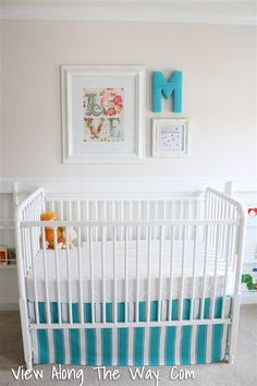 girl nursery. I like the photo and letter set up for above the crib.