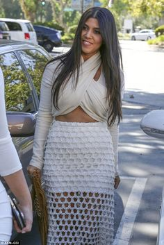 Kourtney, Kim and Khloe Kardashian wear super tight all white outfits #dailymail