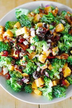 Broccoli salad with bacon, raisins, and cheddar cheese - maybe skip the bacon and sub cow's milk cheddar with goat's milk cheddar... or perhaps manchego?