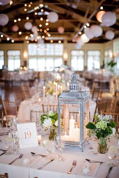 Lantern wedding decor country birdcage centerpiece wedding wedding centerpieces with lanterns wedding table White Flower Centerpieces, Lantern Centerpiece Wedding, Wedding Lanterns, Wedding Table Decorations, Wedding Table Settings, Centerpiece Ideas, Flower Arrangements, Table Flowers, Silver Lanterns