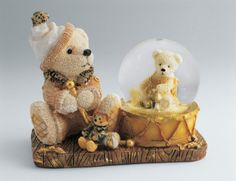Close-up of a teddy bear with a snow globe