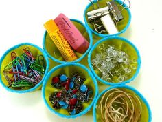 How-To: Turn Soda Bottles into a Desk Organizer | Minus some of the holly hobby touches, this is a good idea.