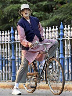 ollywood megastar Amitabh Bachchan rides a cycle during the shooting of his new film 'Piku' in Kolkata.