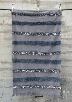 Handmade in: Morocco Width: 3.7ft Length: 6.5ft Materials: Natural wool, cotton and silver sequins. natural wool, cotton and silver sequins. Detail: Newly made. Each piece is one-of-a-kind
