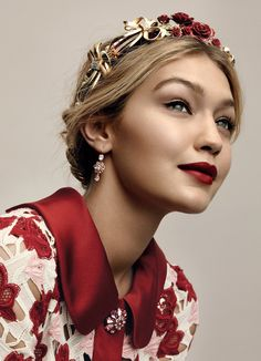 Band Together - Gigi Hadid. Dolce & Gabbana velvet headband, tourmaline earrings, and knit dress; select Dolce & Gabbana boutiques.