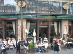 """Paris routinely makes those """"best places to people-watch"""" lists, and it's easy to see why. Parisians take their cafe culture seriously, and the idea of grabbing a quick cup on the…"""