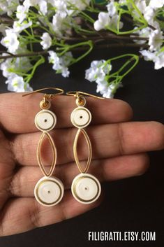 Lightweight, Eco-friendly & handcrafted, these elegant dangle earrings will add a unique touch to your look. Buy these beauties on filigratti.etsy.com.
