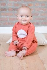 modern-kids.com organic romper in red clay/circle.  Perfect for a lazy day or a day on the town! Your baby will love the soft organic cotton and you will love to show them off in this adorable modern romper.