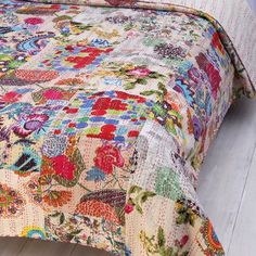 Complement a boho-chic master suite or add a pop of pattern to the guest room with this colorful quilt, showcasing an eclectic patchwork design.