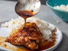 Chicken adobo is a classic Filipino dish that's as savory as it is bright with acid, and it goes perfectly with a large platter of garlic fried rice. Filipino Recipes, Asian Recipes, Ethnic Recipes, Fancy Recipes, Filipino Food, Braised Chicken, Chicken Adobo, Garlic Chicken, Garlic Fried Rice
