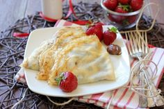 I prefer Crepes to fluffy pancakes. Heres a recipe for crepes, with Nutella and strawberries...good idea! I also like with nutella and bananas,mmmm