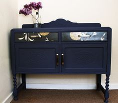 I like this deep blue/purple and also that they used modern handles on a vintage sideboard